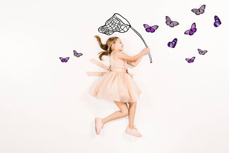 Top view of cheerful kid in pink dress holding butterfly net near butterflies isolated on a white background