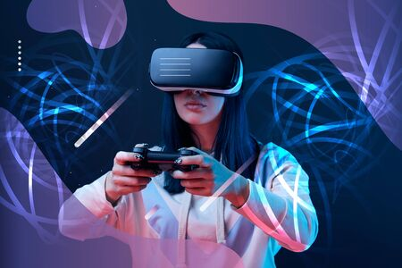 Young woman in virtual reality headset using joystick on dark background with abstract illustration