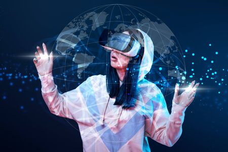 Shocked young woman in vr headset gesturing near glowing globe illustration on dark background