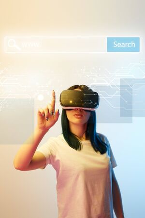 Young woman in vr headset pointing with finger at network illustration with search bar above head on beige and blue background