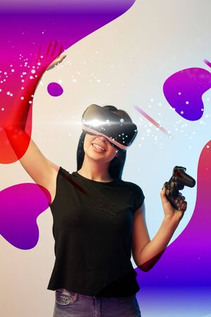 Happy young woman in virtual reality headset with joystick in hands on beige and blue background with abstract illustration