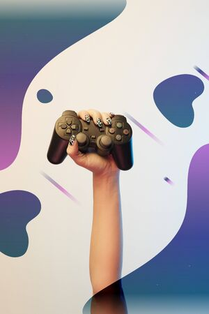 Cropped view of woman holding joystick in hand on beige background with abstract purple and blue illustration
