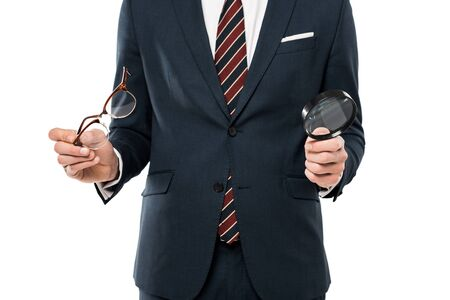 cropped view of businessman holding glasses and magnifying glass isolated on white