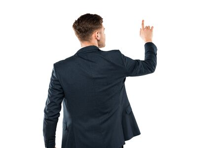 Back view of businessman in suit pointing with finger while standing isolated on white background