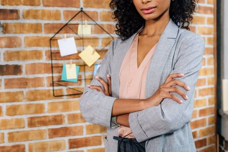 Cropped view of African American Casual businesswoman with crossed arms in loft office Imagens