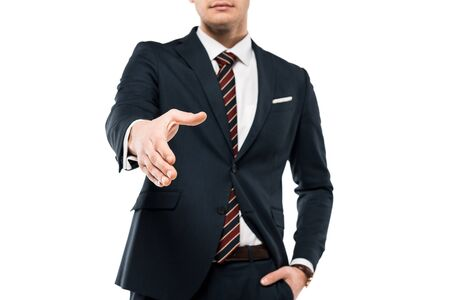 Cropped view of businessman gesturing while standing with hand in pocket isolated on white background