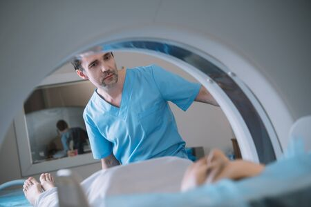 Selective focus of attentive radiologist operating computer tomography scanner during patients diagnostics