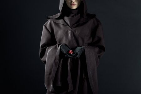 Cropped view of woman in death costume holding dice isolated on black background