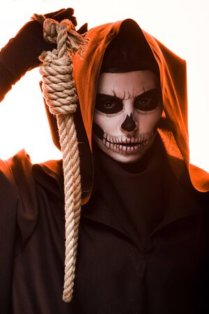 woman in death costume holding hanging noose isolated on white