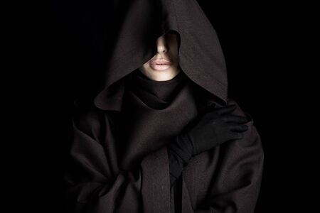 Front view of beautiful woman in death costume isolated on black background Imagens