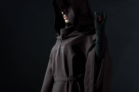 Cropped view of woman in death costume holding dice isolated on black background Imagens - 125073695