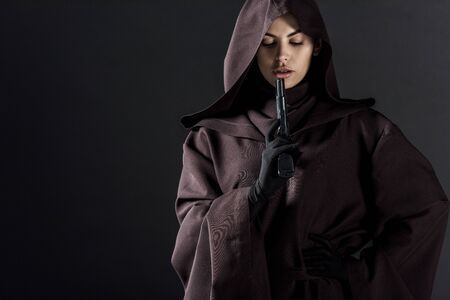 Woman in death costume holding gun isolated on black background Reklamní fotografie - 125073929