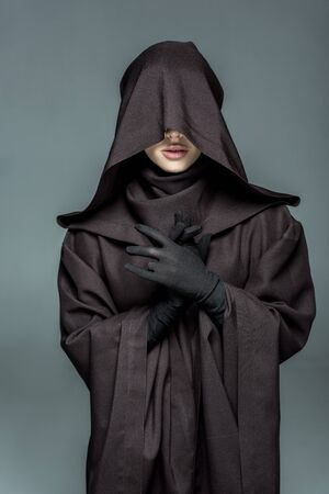 Front view of woman in death costume gesturing isolated on grey background Banco de Imagens