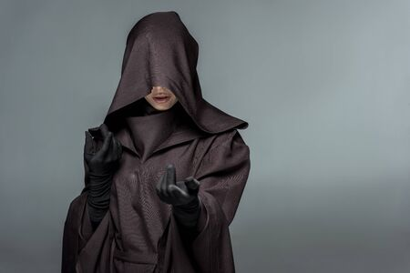 Front view of woman in death costume gesturing isolated on grey background Imagens