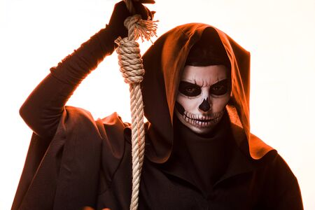 Woman in death costume holding hanging noose isolated on white background