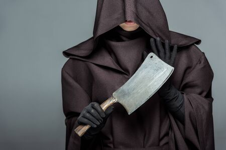 Cropped view of woman in death costume holding cleaver isolated on grey background