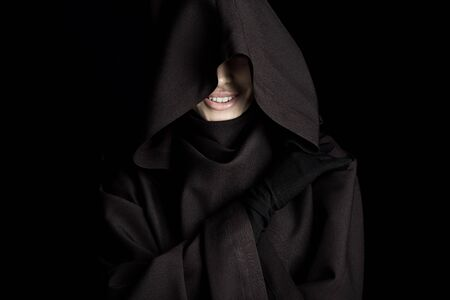 Smiling woman in death costume isolated on black background Imagens