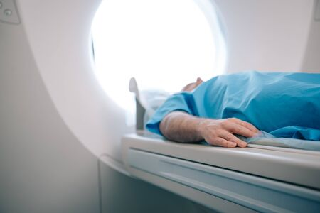 Selective focus of patient lying on ct scanner bed during tomography test