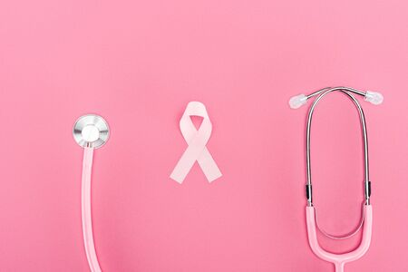 top view of stethoscope and pink breast cancer symbol on pink background Reklamní fotografie
