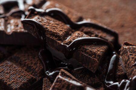 Close up view of pieces of dark chocolate bar with liquid chocolate Stok Fotoğraf