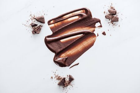 Top view of liquid chocolate with pieces of chocolate and cocoa powder Stok Fotoğraf