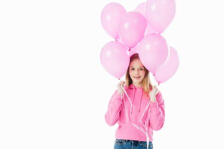 happy teenage girl holding pink balloons isolated on white
