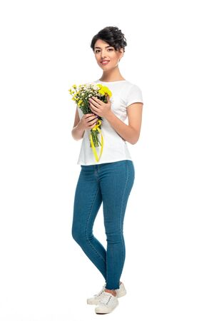 happy latin woman holding flowers and standing isolated on white Stock Photo