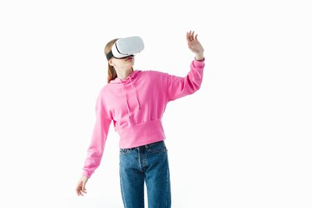teenage girl in pink hoodie and jeans wearing vr headset and gesturing isolated on white