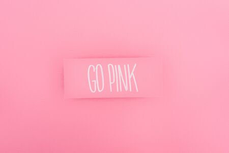 top view of card with go pink lettering on pink background, breast cancer concept