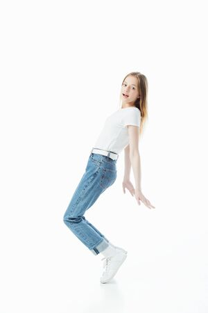 full length view of happy teenage girl dancing isolated on white Stock Photo