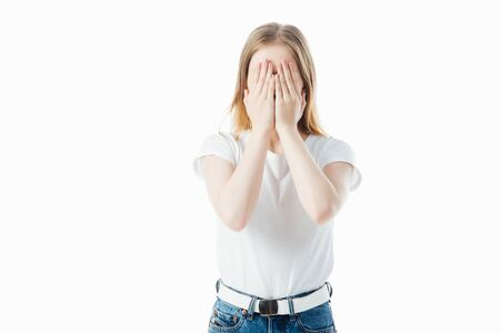 teenage girl covering face with hands isolated on white Stock Photo