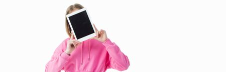 panoramic shot of teenage girl holding digital tablet with blank screen isolated on white