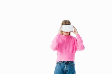 teenage girl in pink hoodie touching vr headset on eyes isolated on white