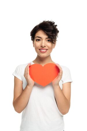happy latin woman holding red heart-shape carton isolated on white Stock Photo