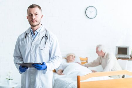 doctor holding clipboard, sick patient and senior man in clinic