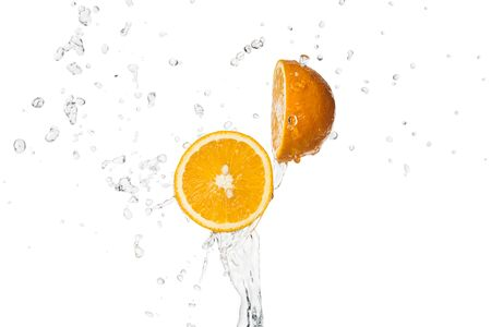 bright orange halves with water splash isolated on white Stock Photo - 125331732
