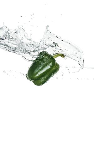 green whole bell pepper with clear water splash isolated on white Stock Photo - 125331919