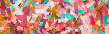 Panoramic shot of multicolored confetti festive background