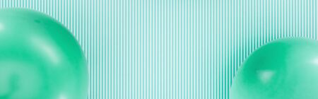 panoramic shot of green balloons on striped background Stock Photo - 125331933