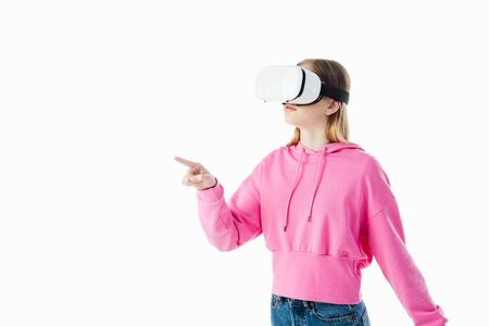 teenage girl in pink hoodie wearing vr headset and pointing with finger isolated on white Stock Photo
