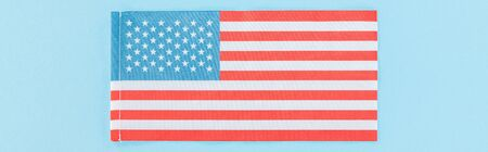 panoramic shot of national american flag on blue background