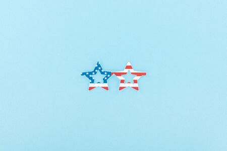 top view of paper cut decorative glasses made of american flag on blue background Stock Photo - 125332603