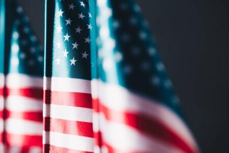selective focus of united states of america national flags isolated on black, memorial day concept Stock Photo