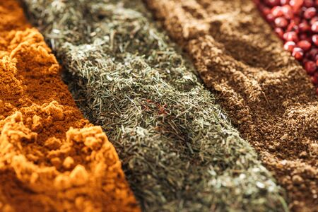 close up view of various aromatic traditional indian spices