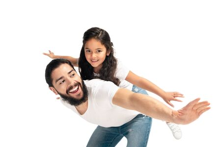 happy latin father carrying on back cute daughter with outstretched hands isolated on white