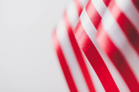 stripes of american national flags isolated on grey, memorial day concept