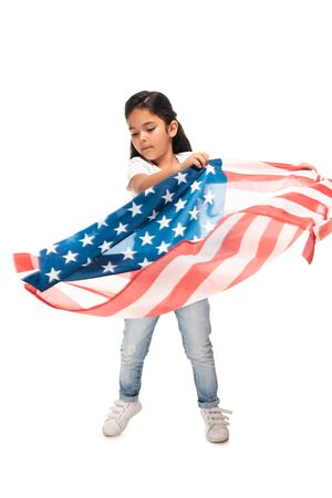latin kid in denim jeans standing with american flag isolated on white