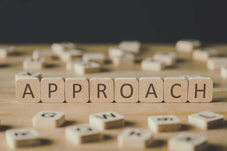 selective focus of word approach made of cubes surrounded by blocks with letters on wooden surface isolated on black Stock fotó