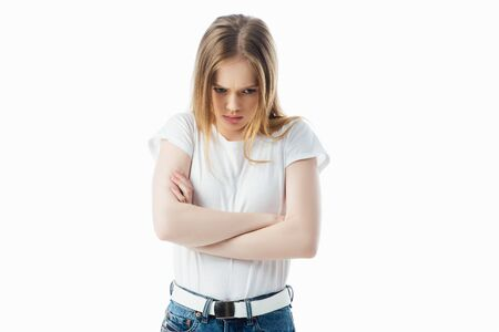 offended teenage girl with crossed arms looking away isolated on white