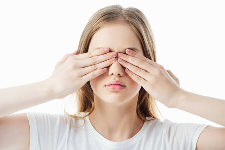 teenage girl covering eyes with hands isolated on white